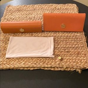 Tory Burch sunglass cases and duster.